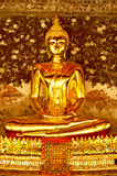 Gold buddha statue. Golden buddha statue in front of the old painting wall , Bangkok Thailand Stock Photography