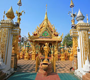 Gold Buddha statue with beautiful temple architecture Royalty Free Stock Photo
