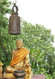 Gold Buddha statue with bell Royalty Free Stock Photography