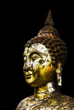 Gold Buddha statue black background. Royalty Free Stock Images