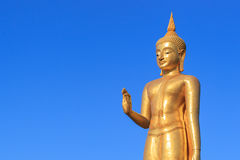 Gold Buddha Statue on blue sky Stock Photo