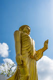 Gold Buddha Statue on blue sky background Royalty Free Stock Photography