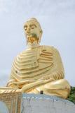 Gold Buddha statue on blue sky Royalty Free Stock Photo