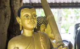 Gold buddha statue. Carrying the umbrellla Stock Photo