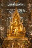 Gold buddha statue in church at buddhist temple Royalty Free Stock Photos