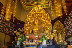 Gold buddha statue of Hase-dera temple in Kamakura, Japan. Kamakura, Japan - November 10, 2016: Gold buddha statue of Hase-dera temple in Kamakura, Japan. Hase Royalty Free Stock Image