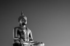 Gold Buddha Statue. In lotus position with mountain background in Thailand Stock Photo