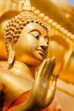 "Gold Buddha statue in Mae Sot, Thailand. ""Generality in Thailand, any kind of art decorated in Buddhist church, temple pavilion, temple hall, monk's house Stock Photography"