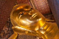 Gold Buddha statue. Reclining gold Buddha statue at Wat Pho Temple, Bangkok, Thailand Stock Image