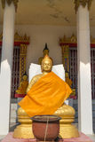 The gold buddha statue sitting with candlestick Stock Images