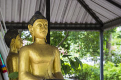 Gold buddha statue. Gold smiling buddha statue in temple of Thailand Royalty Free Stock Photography