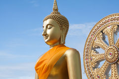 Gold buddha statue in Thai temple with clear sky.WAT MUANG, Ang Thong, THAILAND.