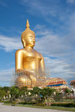 Gold buddha statue under construction in Thai temple with clear sky.WAT MUANG, Ang Thong, THAILAND. Large gold buddha statue is under construction in 2011 at royalty free stock photos
