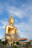 Gold buddha statue under construction in Thai temple with clear sky.WAT MUANG, Ang Thong, THAILAND. Stock Photography