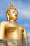 Gold buddha statue under construction in Thai temple with clear sky.WAT MUANG, Ang Thong, THAILAND. Large gold buddha statue is under construction in 2011 at Royalty Free Stock Images