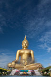 Gold buddha statue under construction in Thai temple with clear sky.WAT MUANG, Ang Thong, THAILAND. Large gold buddha statue is under construction in 2011 at Stock Photo