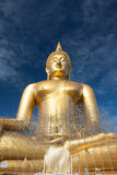Gold buddha statue under construction in Thai temple with clear sky.WAT MUANG, Ang Thong, THAILAND. Large gold buddha statue is under construction in 2011 at Royalty Free Stock Photo