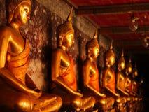 Gold buddha statue Wat Suthat stock photo