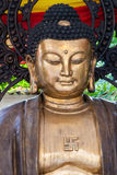 Gold Buddha. In Thailand with rising sun symbol, also know as swastika Royalty Free Stock Image