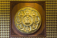 Gold Buddha on the wall Royalty Free Stock Photo