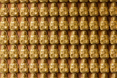Gold Buddha on the wall Stock Photography