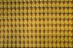 Gold Buddha wall , chinese temple ,thailand Royalty Free Stock Photos