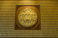 Gold Buddha wall , chinese temple ,thailand Royalty Free Stock Photo