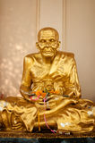 Gold buddhist monk statue Royalty Free Stock Images