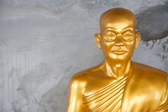 The gold buddhist monk. Stock Image