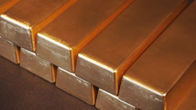 Gold bullion bars. Moving stacks of gold bars stock video footage