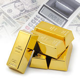 Gold bullion bars stacked on top of each other with financial background Stock Photo