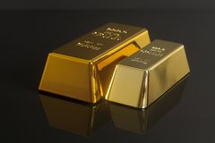 Gold bullion. On black background Stock Photos