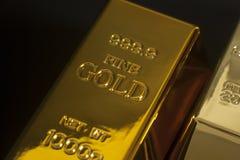 Gold bullion. On black background Royalty Free Stock Images