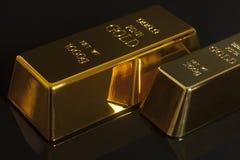 Gold bullion. On black background Stock Images