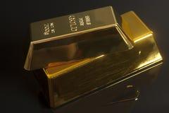 Gold bullion. On a black background Royalty Free Stock Image