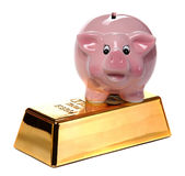 Gold bullion with pink piggy bank Royalty Free Stock Photography