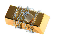 Gold bullion protected with chain and padlock Stock Image