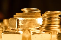 Gold bullions and stack of coins. Background for finance banking concept. Trade in precious metals. Bullions and stack of gold coins macro. Rows of coins and stock photos