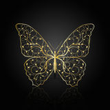 Gold butterfly with floral pattern. stock photo