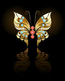 Gold butterfly with gems Stock Photos