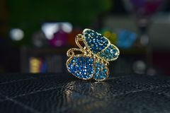 Gold butterfly rings decorated with beautiful aquamarine as jewelry royalty free stock images