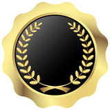 Gold button with laurel wreath Stock Photography