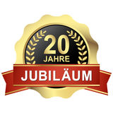 Button 20 years jubilee & x28;in german& x29;. Gold button with red banner for 20 years jubilee & x28;text in german& x29 Stock Images