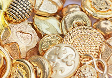 Gold Buttons. Close up shot of various designs of gold color buttons Stock Photography