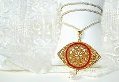 Gold byzantine eye necklace - greek evil eye jewelry Royalty Free Stock Photo