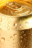 Gold can of drink Stock Images