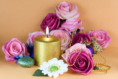 Gold Candle 02. Golde candle and flowers arrangement Royalty Free Stock Photography