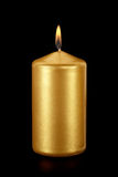 Gold candle on black Royalty Free Stock Photo