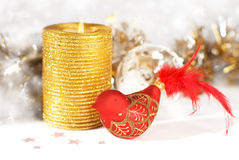 Gold candle with decorative bird Royalty Free Stock Photo