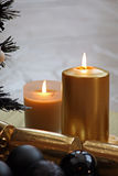 Gold candles Royalty Free Stock Image
